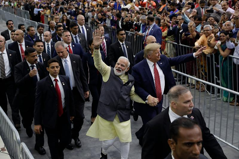 President Donald Trump and Indian Prime Minister Narendra Modi walk around NRG Stadium waving to the crowd during the