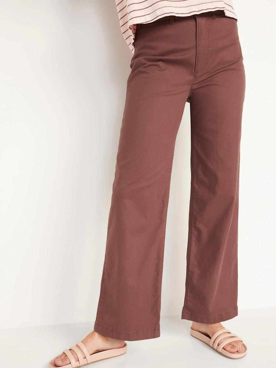 """<p>Match these long <span>Old Navy Extra High-Waisted Wide-Leg Pants</span> ($33, originally $35) with sandals on a warm fall day and your <a href=""""https://www.popsugar.com/fashion/Best-White-Sneakers-Women-46178959"""" class=""""link rapid-noclick-resp"""" rel=""""nofollow noopener"""" target=""""_blank"""" data-ylk=""""slk:favorite white sneakers"""">favorite white sneakers</a> when it gets colder instead.</p>"""