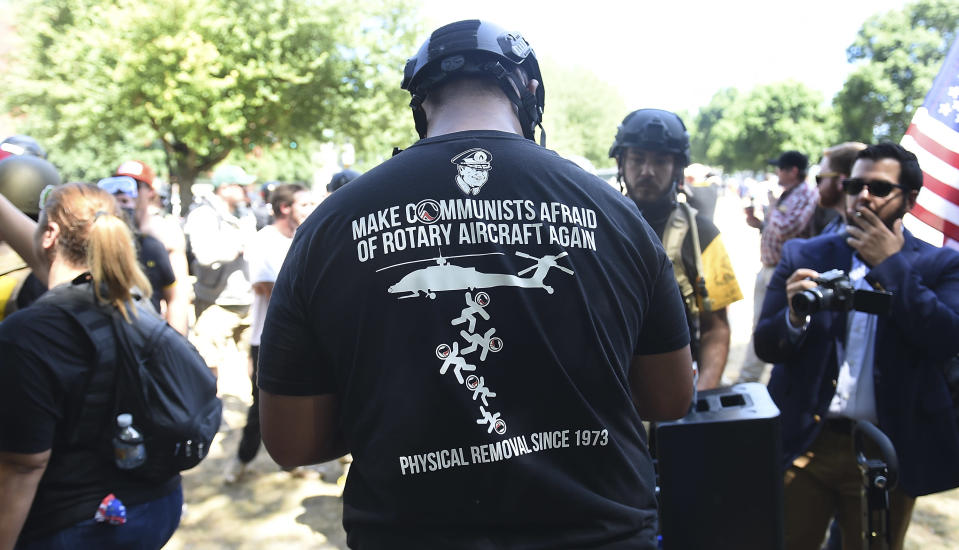 <p>Members of Patriot Prayer demonstrate during the alt-right rally at Tom McCall Waterfront Park on Aug. 4, 2018 in Portland, Ore. (Photo: Steve Dykes/Getty Images) </p>