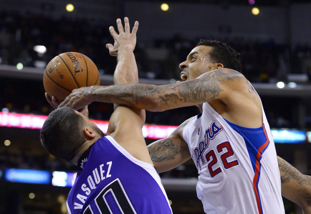 Los Angeles Clippers small forward Matt Barnes, right, puts up a shot as Sacramento Kings point guard Greivis Vasquez defends during the first half of their NBA basketball game, Friday, Oct. 25, 2013, in Los Angeles. (AP Photo/Mark J. Terrill)