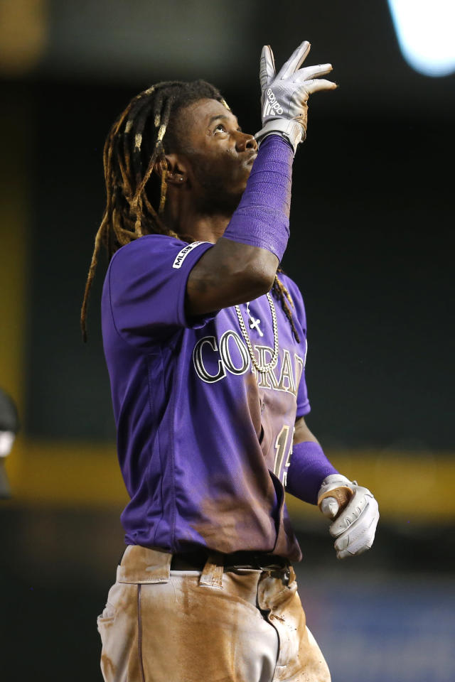 Colorado Rockies' Raimel Tapia reacts after hitting a single in the seventh inning during a baseball game against the Arizona Diamondbacks, Tuesday, Aug. 20, 2019, in Phoenix. (AP Photo/Rick Scuteri)