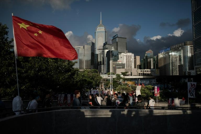 A Chinese national flag is seen outside the city's legislature in Hong Kong