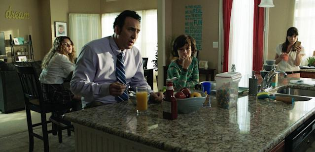 Nicolas Cage and Blair share breakfast with their onscreen kids in one of the happier moments in <em>Mom and Dad</em>. (Photo: Momentum Pictures)