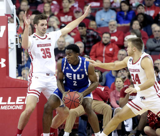 Wisconsin forward Nate Reuvers (35) and guard Brad Davison (34) defend against Eastern Illinois forward Jordan Skipper-Brown (2) during the first half of an NCAA college basketball game in Madison, Wis., Friday, Nov. 8, 2019. (John Hart/Wisconsin State Journal via AP)