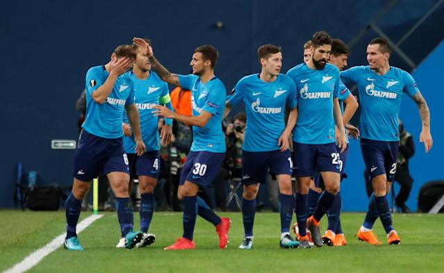 Soccer Football - Europa League Round of 32 Second Leg - Zenit Saint Petersburg vs Celtic - Stadium St. Petersburg, Saint Petersburg, Russia - February 22, 2018 Zenit St. Petersburg's Branislav Ivanovic celebrates with team mates after scoring their first goal REUTERS/Anton Vaganov