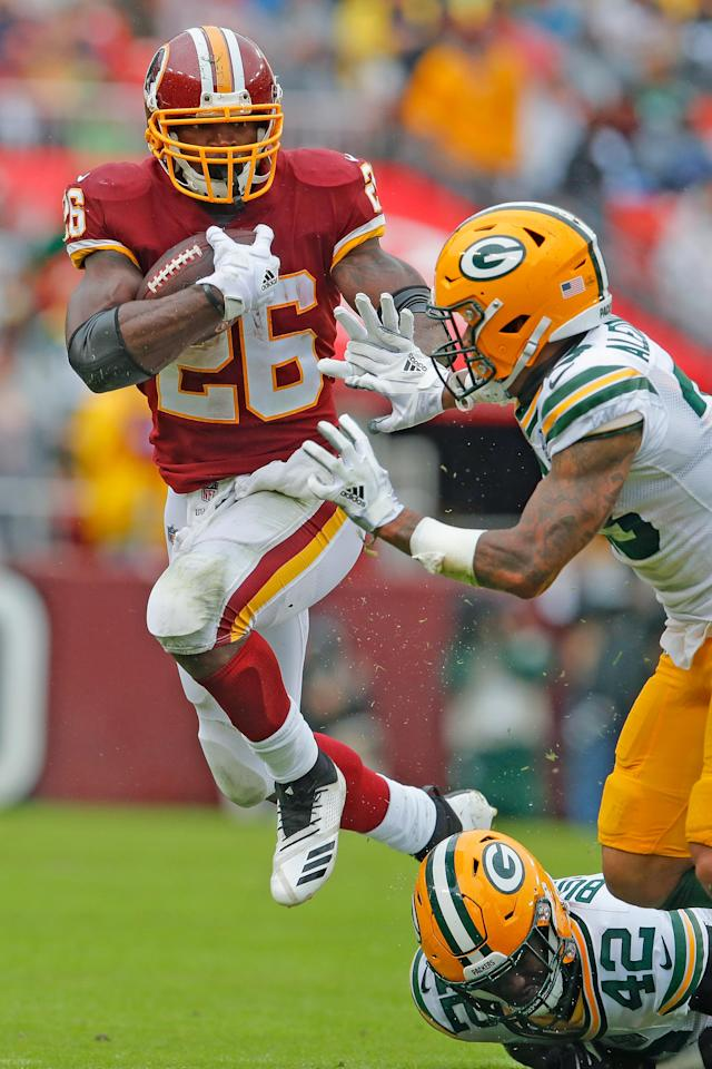<p>Washington Redskins running back Adrian Peterson (26) carries the ball past Green Bay Packers cornerback Jaire Alexander (23) during the first half of an NFL football game, Sunday, Sept. 23, 2018, in Landover, Md. (AP Photo/Carolyn Kaster) </p>