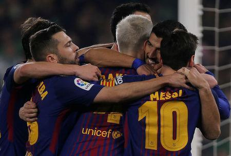 Soccer Football - La Liga Santander - Real Betis vs FC Barcelona - Estadio Benito Villamarin, Seville, Spain - January 21, 2018 Barcelona's Luis Suarez and Lionel Messi celebrate a goal with team mates REUTERS/Jon Nazca