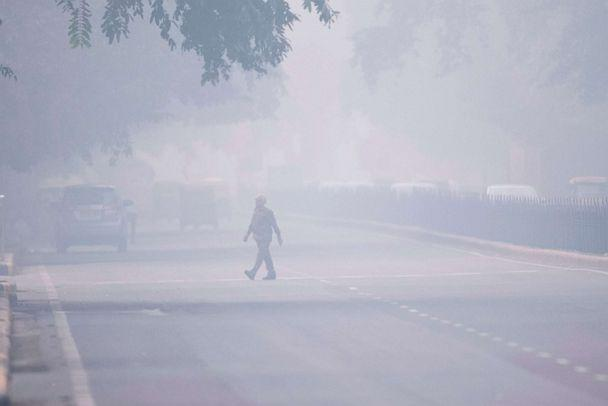 PHOTO: A man crosses a street in smoggy conditions in New Delhi on Nov. 4, 2019. (Jewel Samad/AFP via Getty Images)