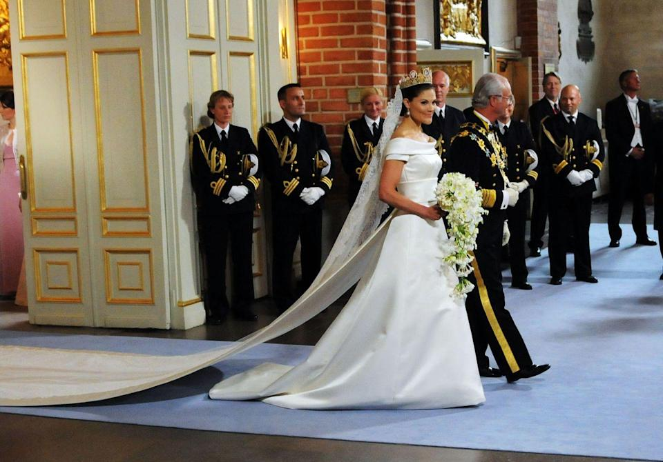 <p>Crown Princess Victoria's gown was created by Swedish designer Pär Engsheden and included an off-the-shoulder neckline and cinched detailing at the waist.</p>