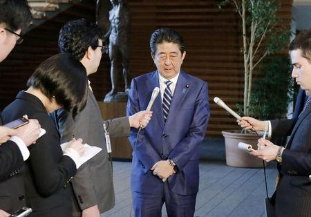 Japanese Prime Minister Shinzo Abe tells reporters at his office in Tokyo on March 12, 2018, that he deeply apologizes to the public over the Finance Ministry's alternations of documents over a state land sale. Mandatory credit Kyodo/viaREUTERS