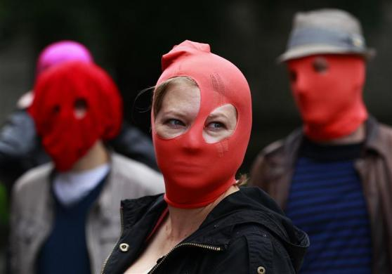 Protestors gather outside the Russian Consulate General building during a demonstration of support for the female Russian female punk band Pussy Riot in Edinburgh, Scotland August 17, 2012.
