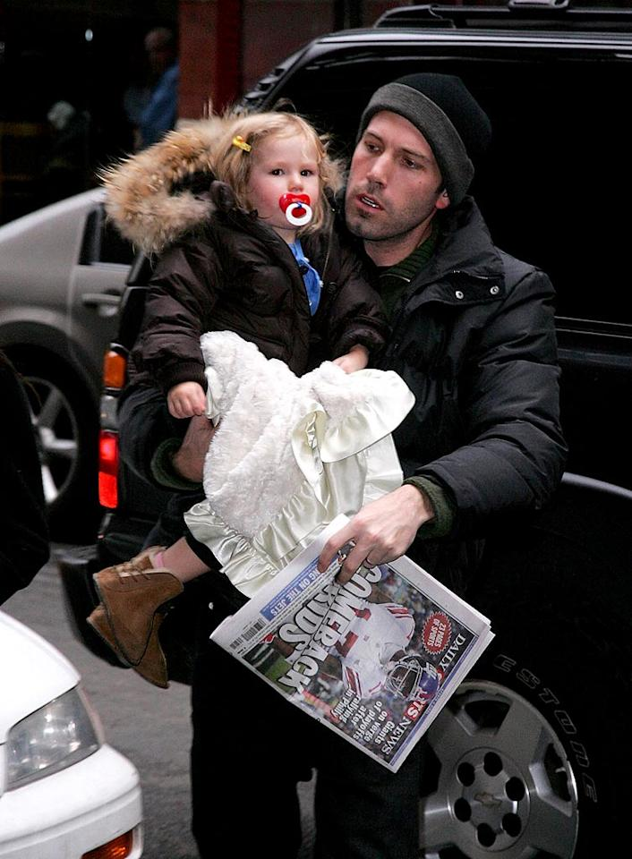"Ben Affleck manages to carry his daughter, her blanket, and a copy of the news. Doesn't Violet look adorable in her barrettes and mini parka? James Devaney/<a href=""http://www.wireimage.com"" target=""new"">WireImage.com</a> - December 10, 2007"