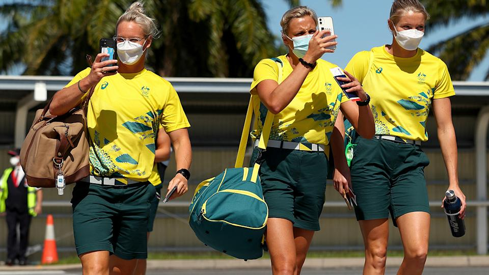 Australian athletes, pictured here on the tarmac at Cairns Airport as they head to Tokyo.