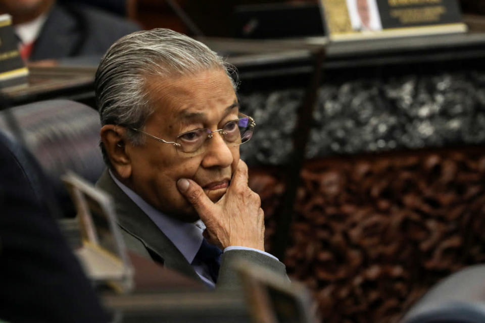 Former Prime Minister Tun Dr Mahathir Mohamad reacts during a session of the lower house of parliament, in Kuala Lumpur, Malaysia July 13, 2020. — Reuters pic