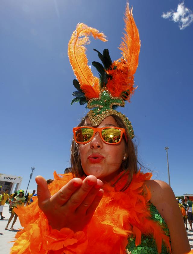 A soccer fan blows a kiss before the start of the 2014 World Cup round of 16 game between Netherlands and Mexicoat the Castelao arena in Fortaleza June 29, 2014. REUTERS/Eddie Keogh (BRAZIL - Tags: SOCCER SPORT WORLD CUP)