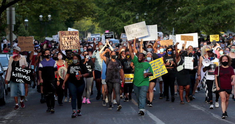 FILE - In this June 28, 2020, file photo, hundreds of protesters march down Waterman Boulevard headed to St. Louis Mayor Lyda Krewson's home in St. Louis. The protesters demanded Krewson's resignation after she read the names and addresses of several residents who supported defunding the police department during an online briefing. (Robert Cohen/St. Louis Post-Dispatch via AP, File)