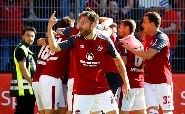 Soccer Football - 2. Bundesliga - SV Sandhausen v Nuremberg - BWT-Stadion am Hardtwald, Sandhausen, Germany - May 6, 2018 Nurnberg 's Lukas Muhl gestures as Tim Leibold celebrates scoring their second goal with team mates REUTERS/Kai Pfaffenbach DFL RULES TO LIMIT THE ONLINE USAGE DURING MATCH TIME TO 15 PICTURES PER GAME. IMAGE SEQUENCES TO SIMULATE VIDEO IS NOT ALLOWED AT ANY TIME. FOR FURTHER QUERIES PLEASE CONTACT DFL DIRECTLY AT + 49 69 650050