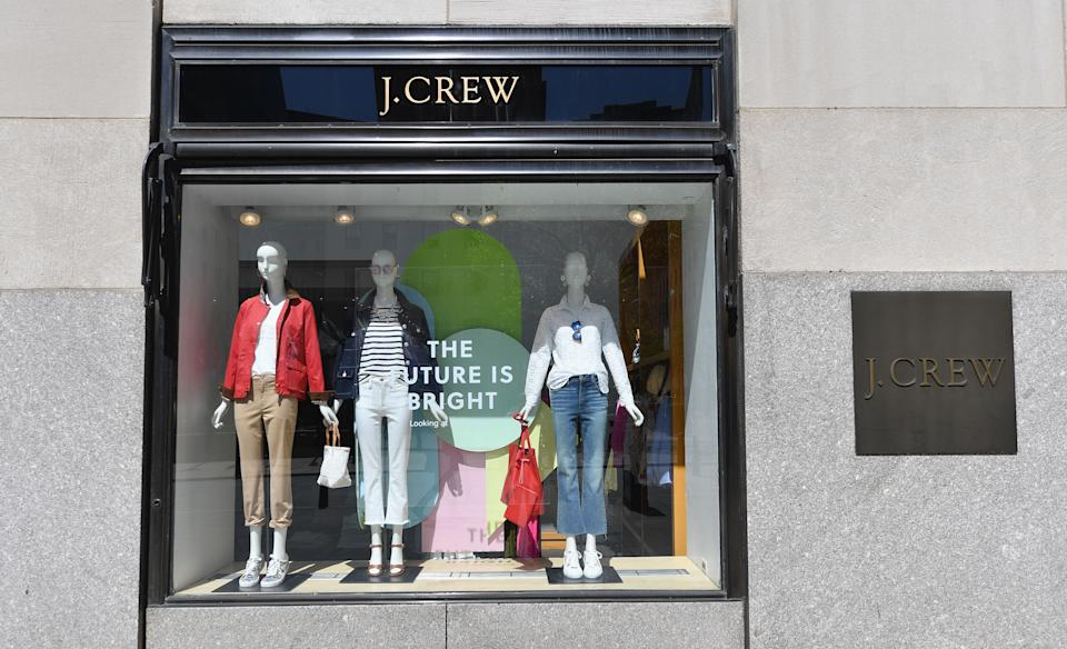 A window display and sign is seen at a closed J.Crew store near Rockefeller Plaza on May 4, 2020 in New York City. - US clothing retailer J. Crew filed to begin bankruptcy protection proceedings Monday, after reaching an agreement with major creditors on a $1.65 billion debt restructuring plan, the company said in a statement. The brand, whose clothes have been worn by former first lady Michelle Obama, said online sales operations, which account for more than half its revenues, will continue as normal. (Photo by Angela Weiss / AFP) (Photo by ANGELA WEISS/AFP via Getty Images)