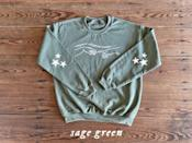 <p>The <span>Taylor Swift <b>Folklore</b> Sweatshirt</span> ($25) comes in such a pretty sage-green color. </p>