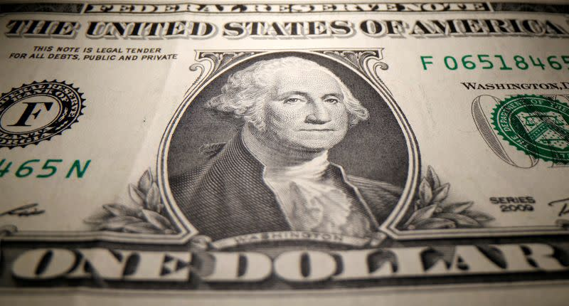 Dollar rises from four-week low as U.S. stocks end mixed