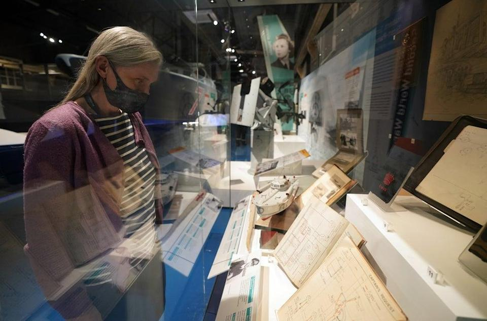 Victoria Ingles, senior curator at the National Museum of the Royal Navy, looks at a display for The Night Hunters: The Royal Navy's Coastal Forces at War exhibition (Andrew Matthews/PA) (PA Wire)