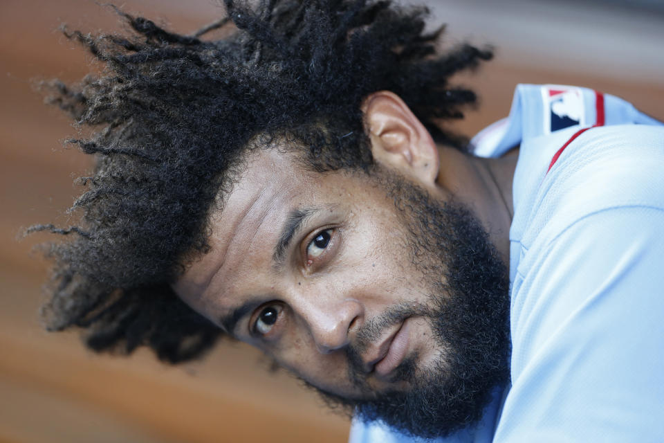 St. Louis Cardinals' Jose Martinez lets a fan blow his hair as he cools off in the dugout during the fifth inning of a baseball game against the Cincinnati Reds, Saturday, July 20, 2019, in Cincinnati. (AP Photo/Gary Landers)