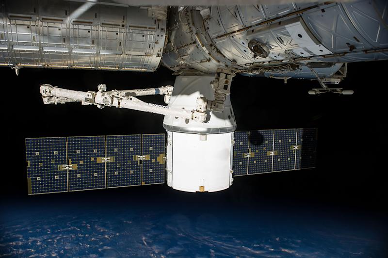 Undated photo shows SpaceX's uncrewed Dragon cargo spacecraft docked to the International Space Station with a load of supplies and equipment for the station crew (AFP Photo/)