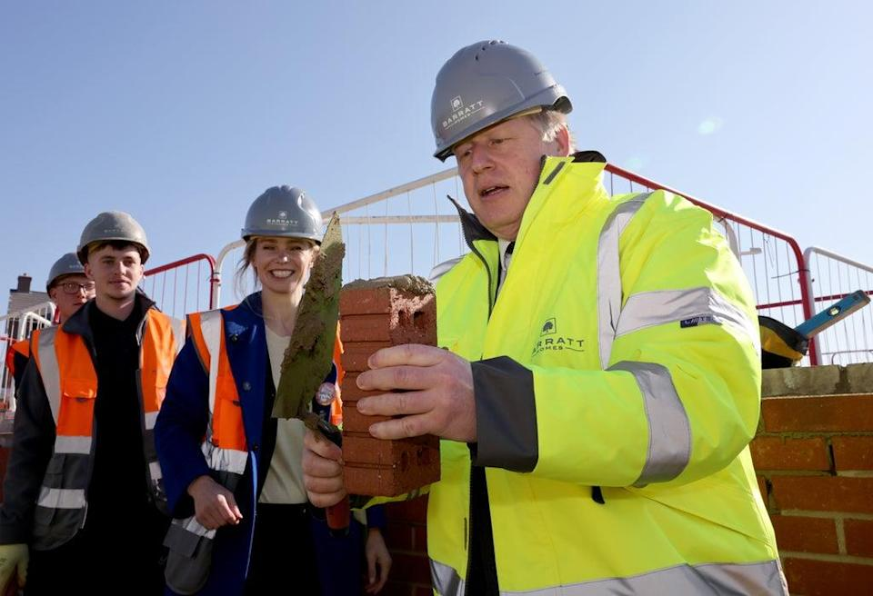 Stroud MP Siobhan Baillie (centre) with Prime Minister Boris Johnson during a visit to a Barratt Homes development site in Great Oldbury, Gloucestershire (PA) (PA Wire)