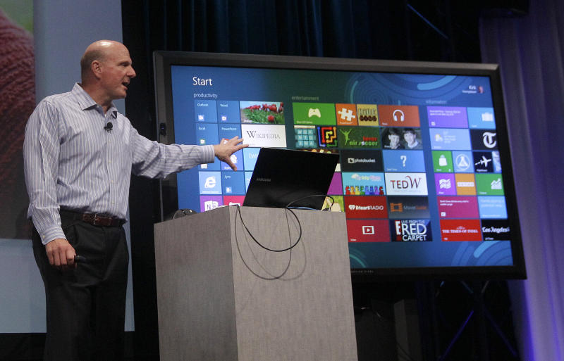 Microsoft CEO Steve Ballmer, Kirk Koenigbauer speaks at a Microsoft event in San Francisco,Monday, July 16, 2012. Microsoft unveiled a new version of its widely used, lucrative suite of word processing, spreadsheet and email programs Monday, one designed specifically with tablet computers and Internet-based storage in mind. (AP Photo/Jeff Chiu)