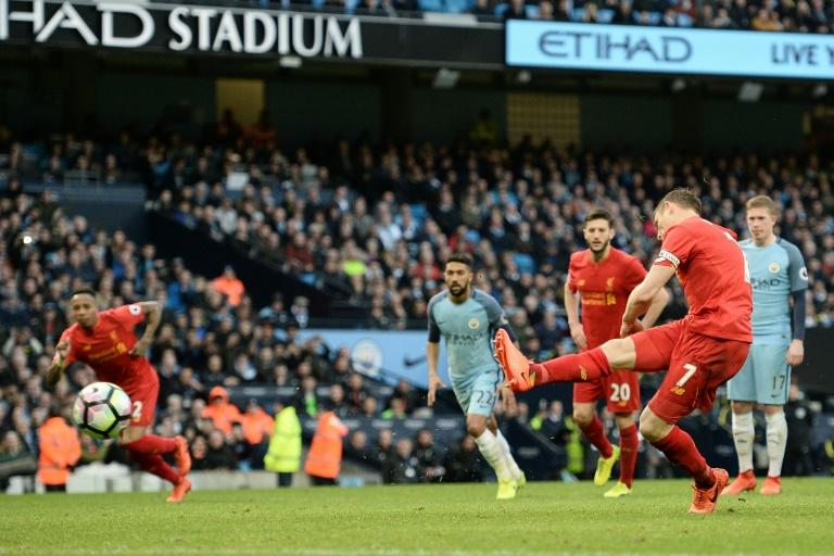 Liverpool's James Milner scores a goal from the penalty spot during their English Premier League match against Manchester City, at the Etihad Stadium in Manchester, on March 19, 2017
