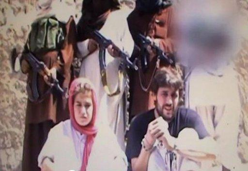 Swiss couple Olivier David Och and Daniela Widmer are shown in a Fata Research Center photo following their abduction in Pakistan. The couple held captive by the Taliban for over eight months were flown back to the capital on Thursday, smiling and waving to the cameras and apparently in good health
