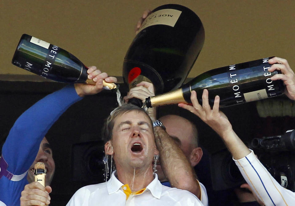 """FILE - In this Oct. 4, 2010, file photo, Europe teammates pour champagne over Ian Poulter as they celebrate winning the 2010 Ryder Cup golf tournament at the Celtic Manor Resort in Newport, Wales. They call him """"The Postman"""" — because come Ryder Cup time, he always delivers. (AP Photo/Jon Super, File)"""