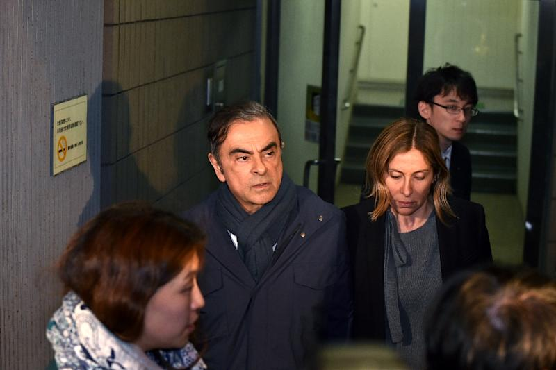 Carole Ghosn stayed close by her husband when he was released on bail (AFP Photo/Kazuhiro NOGI)