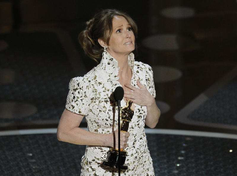 "Melissa Leo accepts her Oscar for ""The Fighter"" on Feb. 27, 2011. (Gary Hershorn / Reuters)"