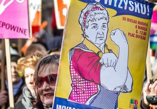 Polish feminists demonstrate in Warsaw during International Women's Day earlier this month. A revolution is under way in Poland as the government moves to cut large subsidies for Poland's powerful Catholic Church and give taxpayers more choice in funding it