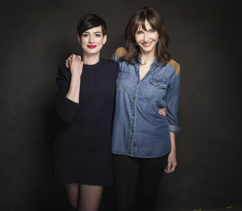"""In this Tuesday, Jan. 21, 2014 photo, cast members Anne Hathaway and Mary Steenburgen pose for a portrait at The Collective and Gibson Lounge Powered by CEG, during the Sundance Film Festival, in Park City, Utah. The actresses starred in the film, """"Song One,"""" directed by Kate Barker-Froyland, which premiered at the 2014 Sundance Film Festival. (Photo by Victoria Will/Invision/AP)"""