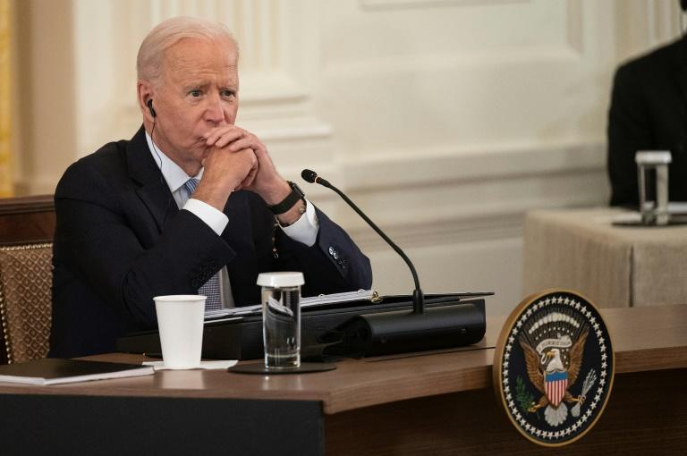 US President Joe Biden listens as India Prime Minister Narendra Modi speaks with Japan Prime Minister Yoshihide Suga and Australian Primer Minister Scott Morrison during the first-ever in-person Quad summit at the White House (AFP/Jim WATSON)