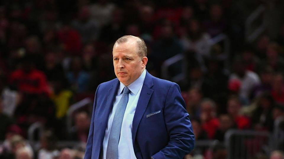 Tom Thibodeau looks on during game in blue suit