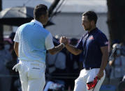 CORRECTS LAST NAME TO SCHAUFFELE FROM SHAUFFELE - Xander Schauffele of the United States, right, is congratulated by Hideki Matsuyama of Japan after winning gold in the men's golf event at the 2020 Summer Olympics on Sunday, Aug. 1, 2021, in Kawagoe, Japan. (AP Photo/Andy Wong)