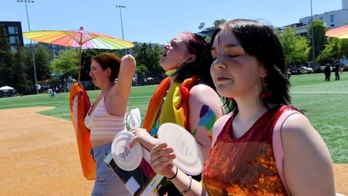 People take part in a Pride rally in Seattle