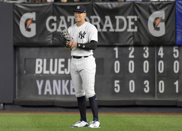 New York Yankees right fielder Aaron Judge smiles after coming into the baseball game in the eighth inning against the Toronto Blue Jays Friday, Sept.14, 2018, at Yankee Stadium in New York. (AP Photo/Bill Kostroun)
