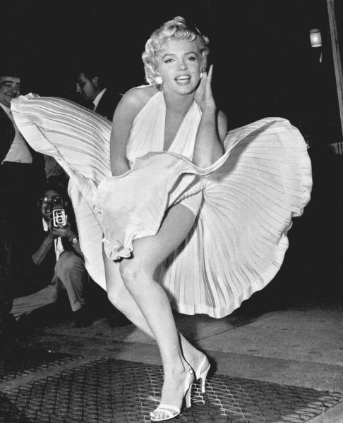 """FILE - In this Sept. 9, 1954 file photo, Marilyn Monroe poses over the updraft of New York subway grating while in character for the filming of """"The Seven Year Itch"""" in Manhattan. The former Norma Jean Baker modeled and starred in 28 movies grossing $200 million. Sensual and seductive, but with an air of innocence, Monroe became one of the world's most adored sex symbols. She died alone by suicide, at age 36 in her Hollywood bungalow. (AP Photo/Matty Zimmerman, File)"""
