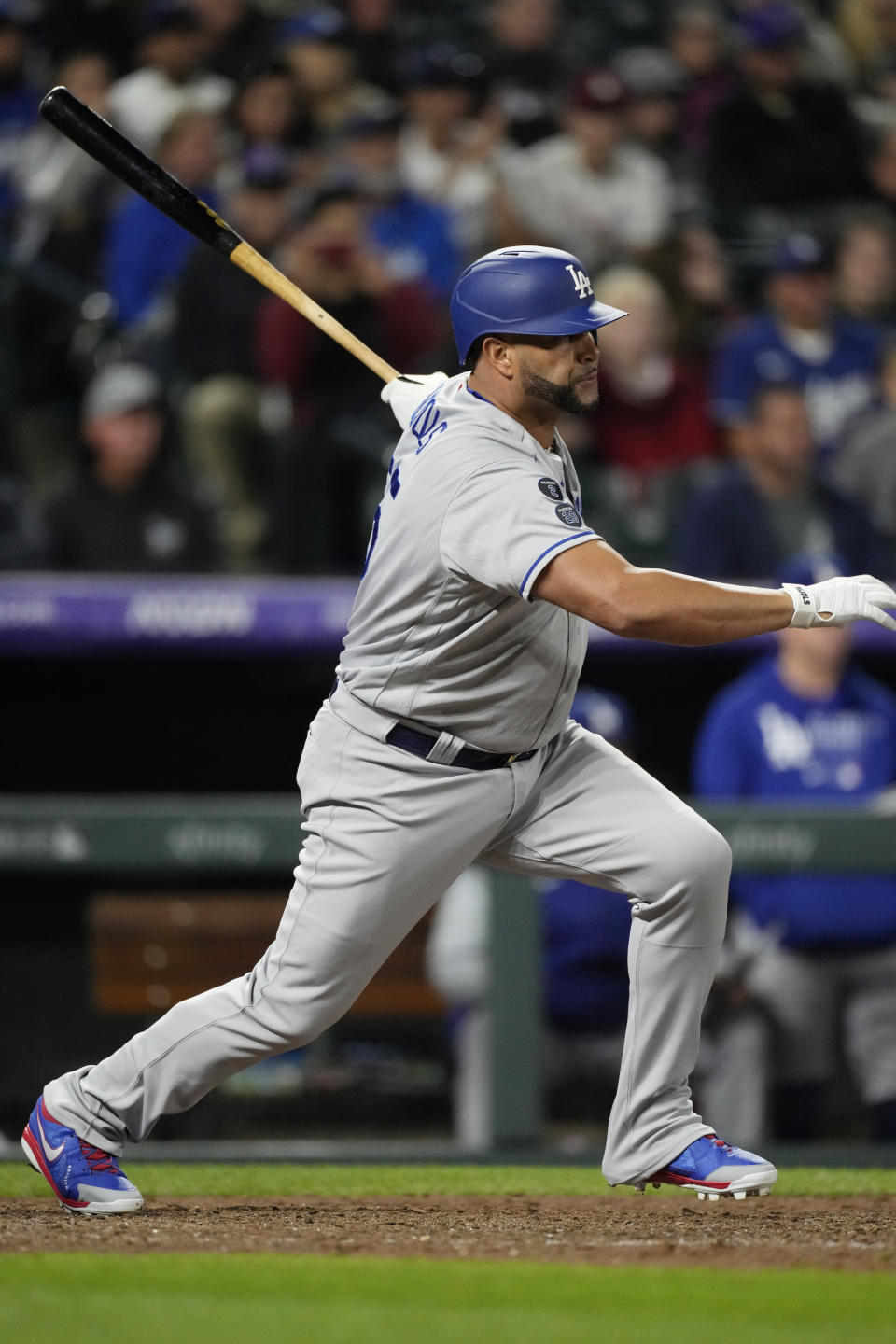 Los Angeles Dodgers pinch-hitter Albert Pujols follows the flight of his RBI-single off Colorado Rockies relief pitcher Jhoulys Chacin in the 10th inning of a baseball game Tuesday, Sept. 21, 2021, in Denver. The Dodgers won 5-4. (AP Photo/David Zalubowski)