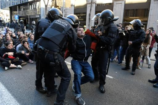 Catalan police dispersed students who blocked a street in Barcelona in protest at the trial of the former separatist leaders