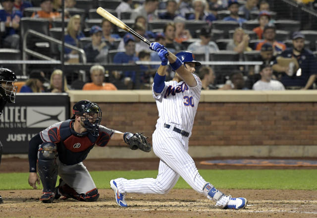New York Mets' Michael Conforto hits a double as Atlanta Braves catcher Tyler Flowers, left, looks on during the sixth inning of a baseball game Wednesday, Sept. 26, 2018, in New York. (AP Photo/Bill Kostroun)
