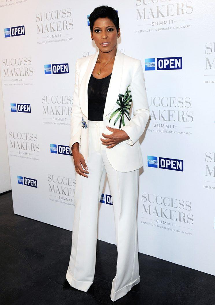 Tamron Hall wearing a white suit