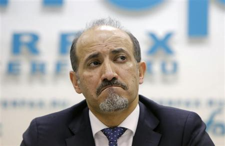 Syrian opposition leader Ahmad Jarba reacts during a news conference in Moscow