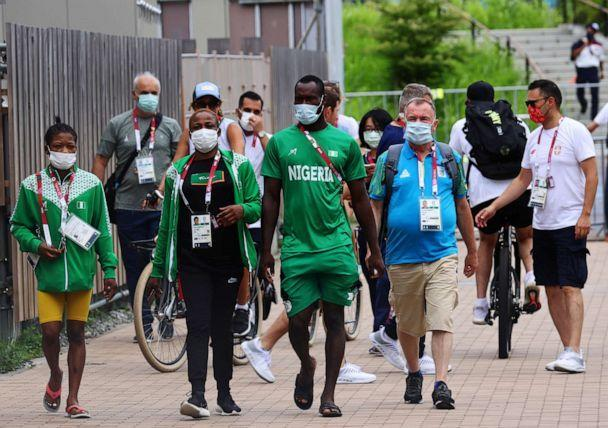 PHOTO: People wearing protective masks, amid the coronavirus disease (COVID-19) outbreak, are seen inside the athletes' village for Tokyo 2020 Olympic Games in Tokyo, Japan, July 29, 2021. (Kim Kyung-hoon/Reuters)