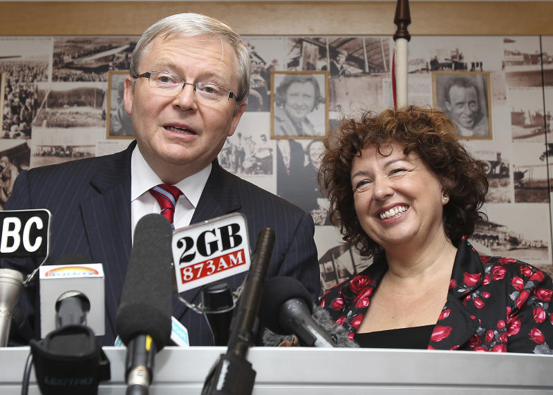 Former Australian Prime Minister and Foreign Minister, Kevin Rudd, left, speaks to  the media, with his wife Therese Rein, right,  during a press conference after his arrival at the airport in Brisbane, Australia, Friday, Feb. 24, 2012.  Prime Minister Julia Gillard put her job on the line Thursday, announcing a leadership ballot in hopes of quashing a comeback by Rudd, the colleague she ousted in a Labor Party coup nearly two years ago.  The vote by party lawmakers, scheduled for Monday, is an effort by Gillard to knock down a power struggle that has been percolating for weeks, and that spilled over onto the world stage Wednesday when Rudd resigned as foreign minister during an official trip to the U.S.  (AP Photo/Tertius Pickard)