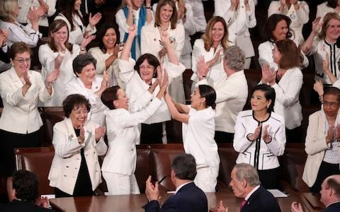Democratic female members of Congress wear white to celebrate there being more female members than ever - Credit: JONATHAN ERNST /REUTERS